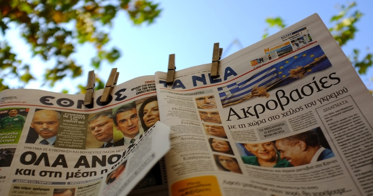 Greek newspapers with headlines and prime minister George Papandreou on the front pages on November 04, 2011 in Athens, Greece. Greece stands on the brink of economical collapse as political disagreements continue concerning the financial aid package proposed by EU.</p>