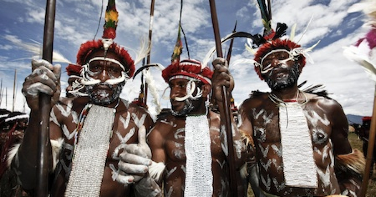 Papuanese tribal men pose for a photograph during the Baliem Valley Festival on August 9, 2010 in Wamena, Indonesia.</p>