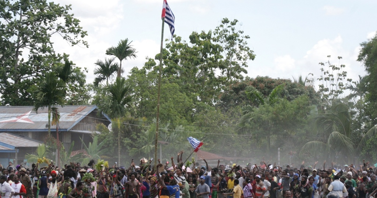 It's not the first time the Indonesian province of Papua has been rocked by violence. Here Papuan demonstrators erupt in a short-lived celebration as they raise the banned Morning Star flag on a bamboo pole in Timika on Dec. 1 2011, the 50th anniversary of the region's claim to independence. Indonesian police and troops opened fire soon after.</p>
