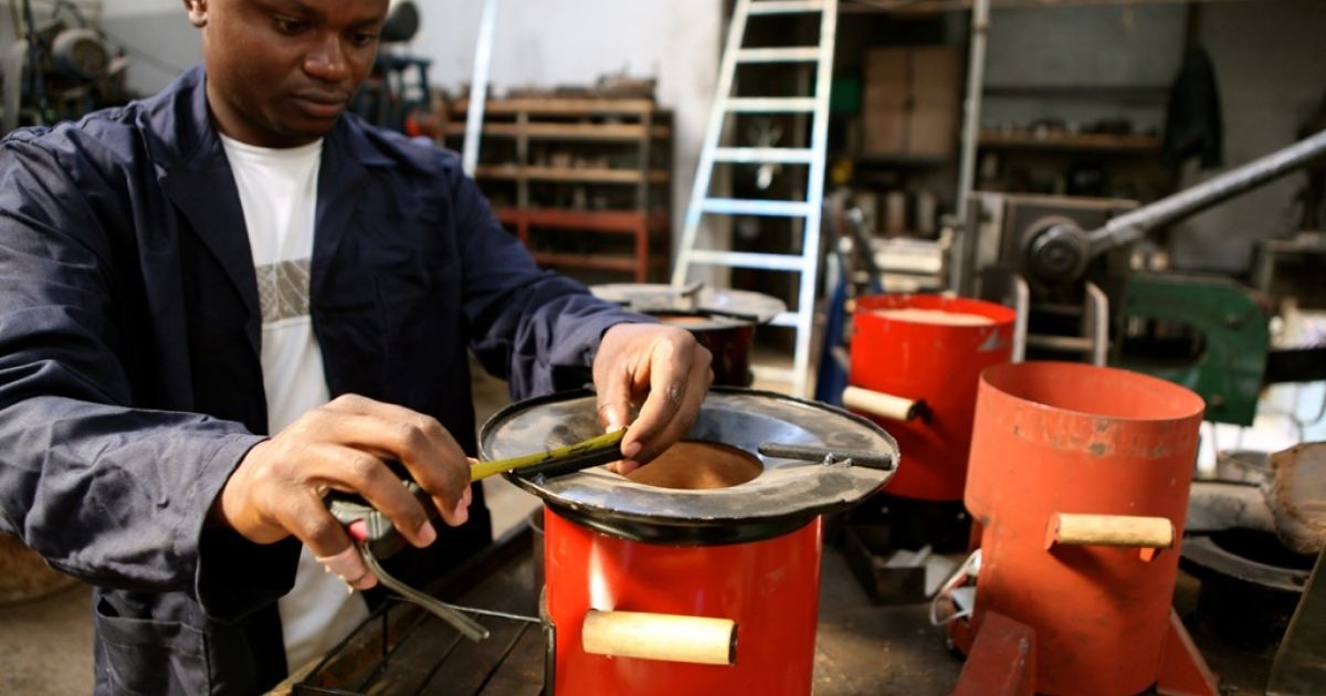 John Irungu, one of Paradigm Kenya's team, checks a new batch of the environmentally-friendly Jiko Poa stoves by measuring the dimensions of the hot plate.</p>