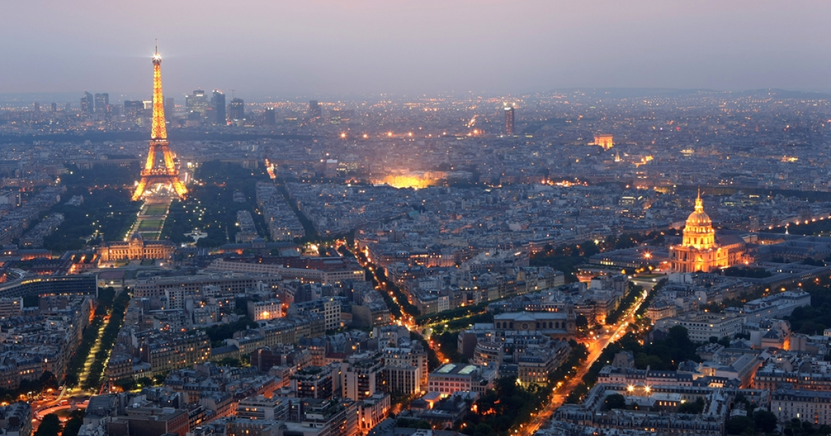General view of Paris at dusk with the Eiffel Tower and  the Hotel des Invalides prominent on June 10, 2008 in Paris, France.</p>