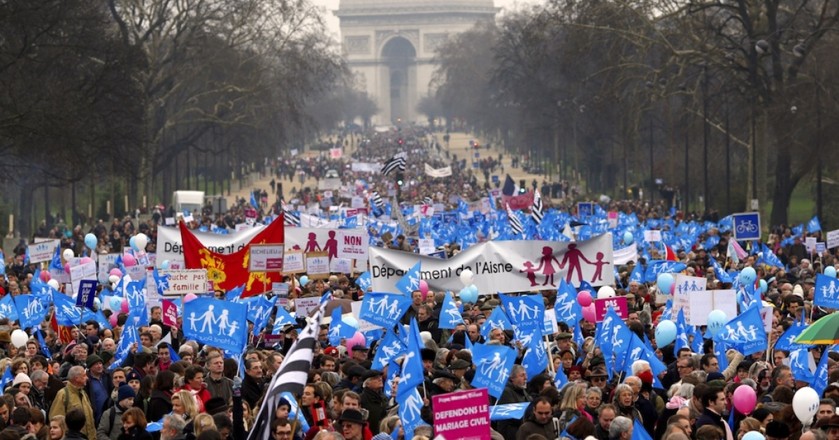 People take part in a protest organized by French far-right party Front national (FN) party against same-sex marriage in Paris on Jan 13, 2013.</p>
