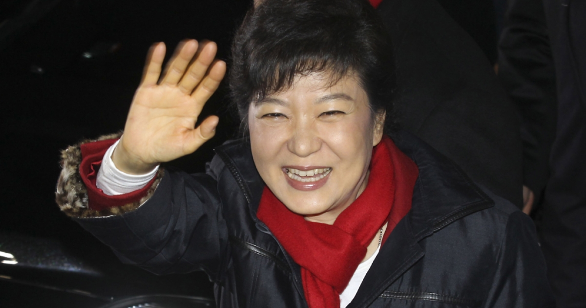 South Korean President-elect Park Geun-Hye, of the ruling Saenuri Party, waves to supporters after she is declared the winner of the presidential elections on Dec. 19, 2012 in Seoul, South Korea. Park, daughter of former president Park Chung-Hee, becomes the first female president of South Korea.</p>