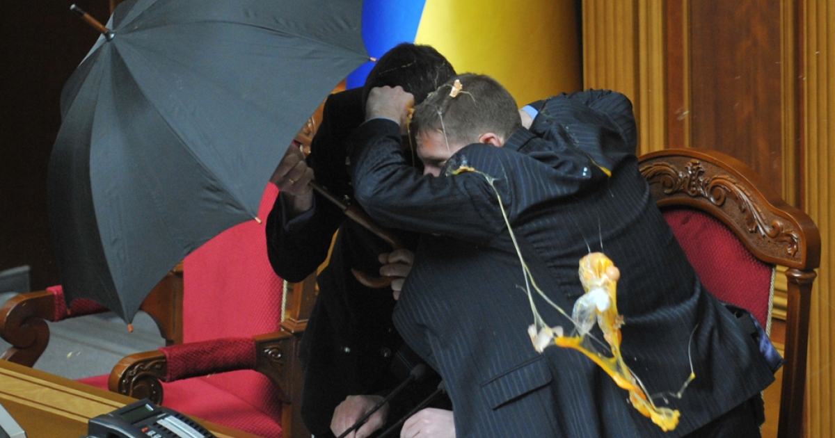 Food often surfaces in political debate in Ukraine. Here, security personnel protect with umbrellas Speaker of Ukraine's parliament Volodymyr Lytvyn during a fight at a parliament sitting in Kiev on April 27, 2010. Smoke bombs and eggs were thrown as Ukraine's parliament ratified a bitterly controversial deal with Russia extending the lease of a key naval base.</p>