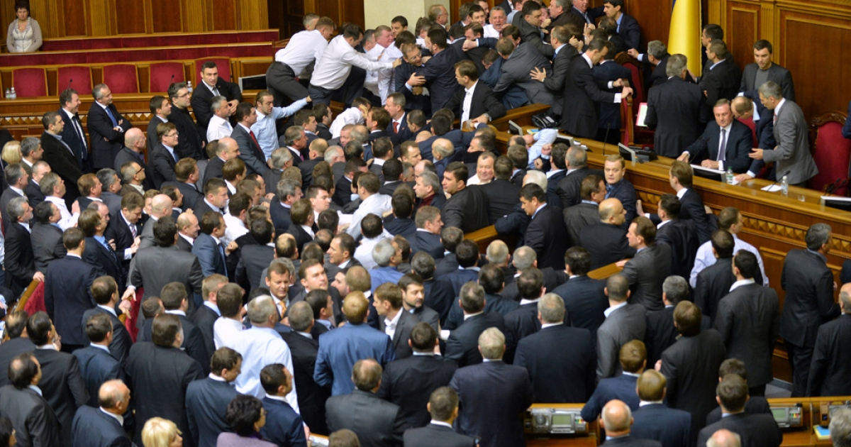 KIEV, UKRAINE:  Deputies of the opposition fight with deputies of the majority for a second time in two days, during the second session of the newly elected Ukrainian parliament in Kiev on December 13, 2012.  The opening session of the Verkhkovna Rada began in a typically raucous fashion, after the October 28 parliamentary elections which were condemned by the West as a setback for democracy.  A fight erupted in the chamber between opposition MPs and two deputies whom they accused of defecting to the pro-government camp. Several lawmakers from the opposition nationalist Svoboda group chased two men they called