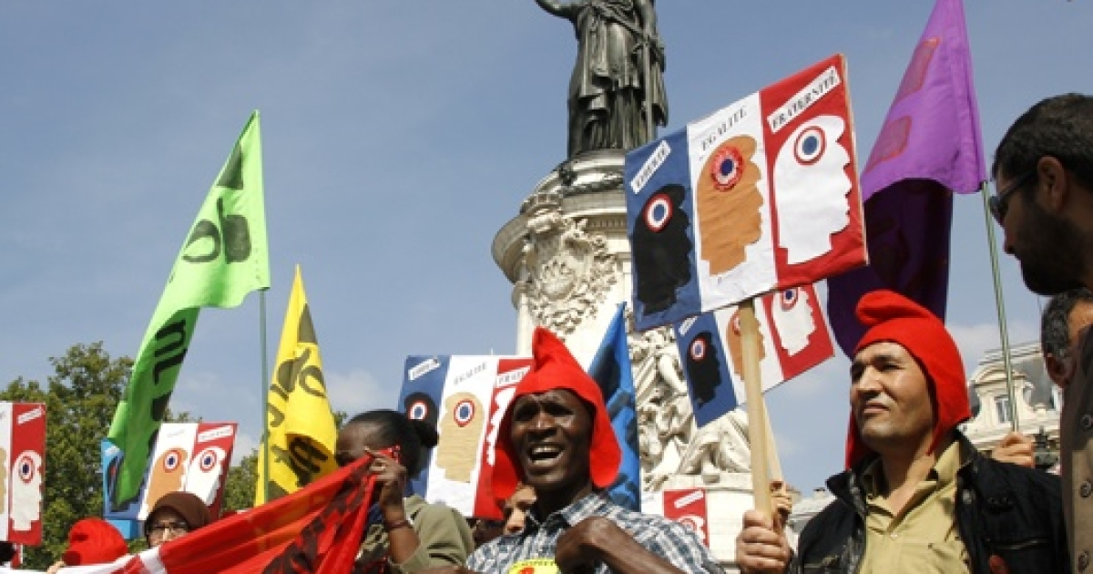 French opposition parties, unions, and civil rights groups protest President Nicolas Sarkozy's expulsions of Gypsies and Roma people at the Place de la Republique in Paris, September 4, 2010.</p>