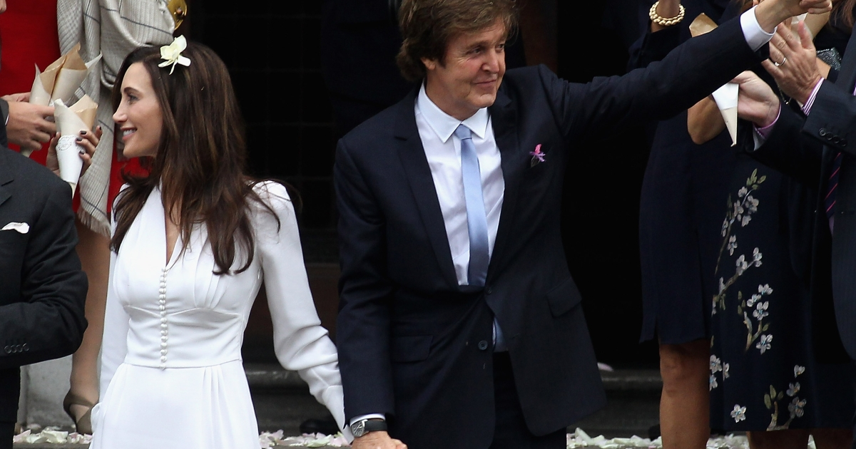 Paul McCartney and Nancy Shevell leave the Marylebone Registry Office after their civil ceremony marriage on October 9, 2011 in London, England. The Marylebone registry office was where McCartney married his first wife, Linda.</p>