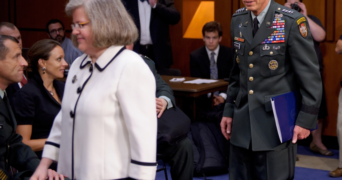 A June 23, 2011 photo shows Paula Broadwell (2nd L) watching as General David Petraeus (R) and his wife Holly Petraeus (3rd L) arrive for a Senate Select Intelligence Committee hearing on Petraeus' nomination to be director of the Central Intelligence Agency (CIA) in the Hart Senate Office Building on Capitol Hill in Washington. Petraeus resigned as director of the Central Intelligence Agency on November 9, 2012 after admitting to an extramarital affair with Broadwell.</p>