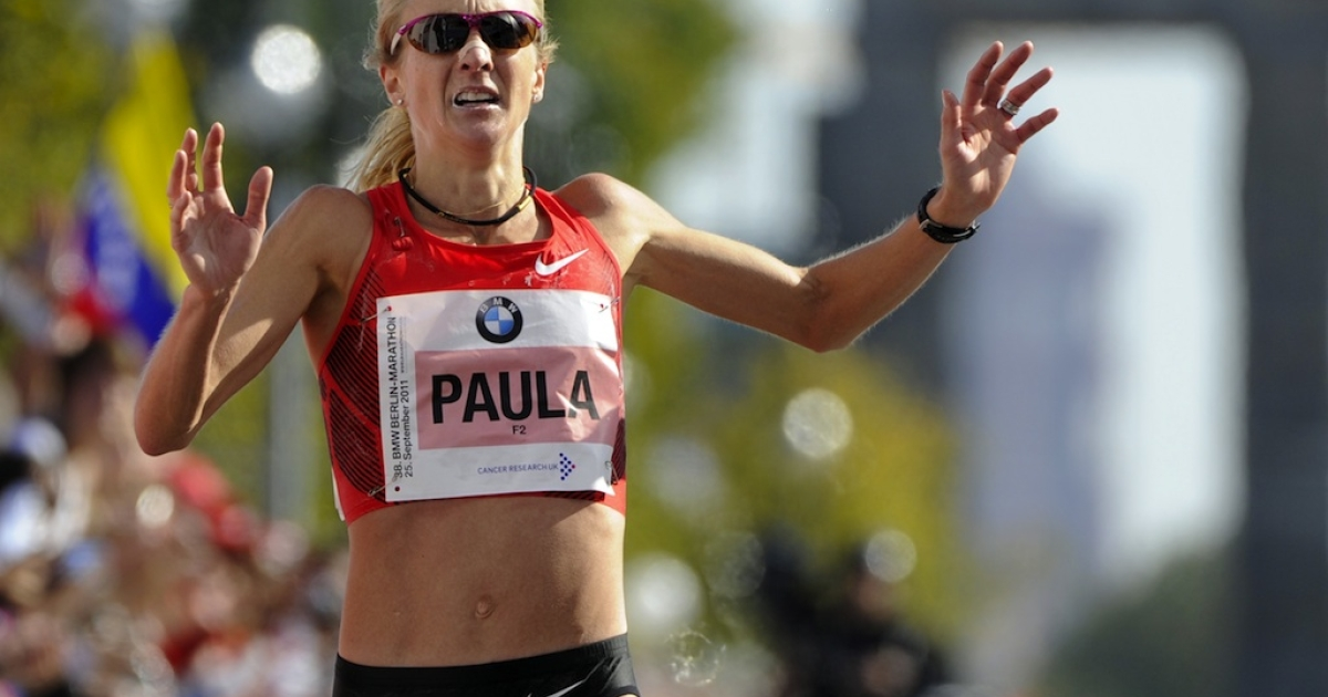 Paula Radcliffe crosses the finish line of the women's event of the 38th Berlin Marathon on September 25, 2011.</p>