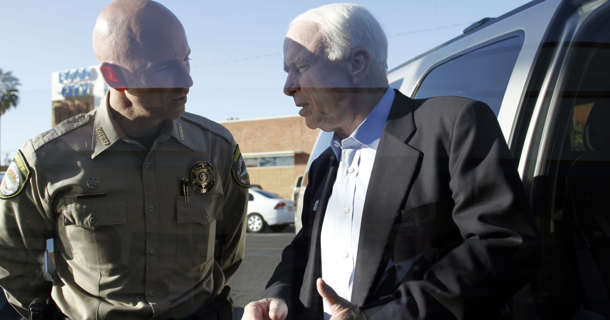 Pinal County Sheriff Paul Babeu, left, speaks with US Sen John McCain during campaigning in April 2010 in Casa Grande, Arizona.</p>