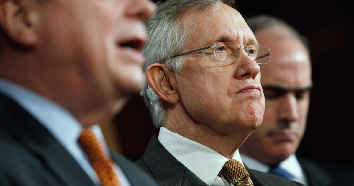 Senate Majority Leader Harry Reid holds a news conference about the payroll tax cut. The Senate late Wednesday passed a bill to end the government shutdown and avoid US default after more than two weeks of bickering among House and Senate leaders.</p>