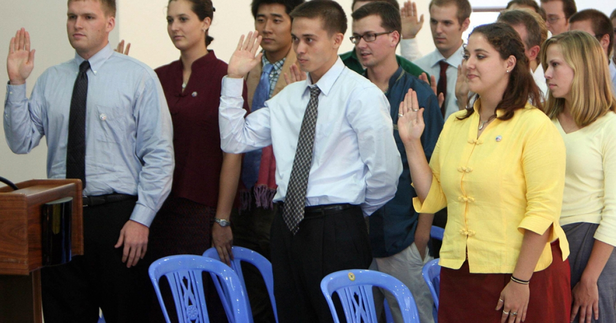 Volunteers during a Peace Corps swearing-in ceremony at the National Institute of Education in Phnom Penh. Today, the organization announced plans to scale back its efforts in South America due to increased violence.</p>
