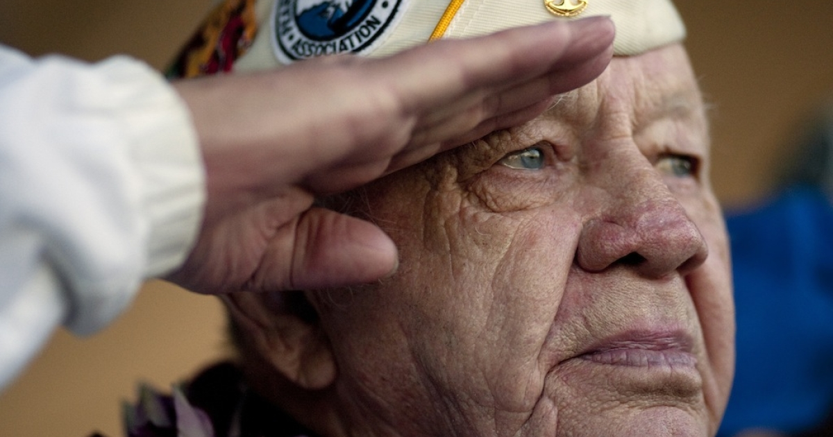 PEARL HARBOR, HAWAII - DECEMBER 7:   Howard Snell salutes the American Flag on December 7, 2010 in Pearl Harbor, Hawaii.</p>
