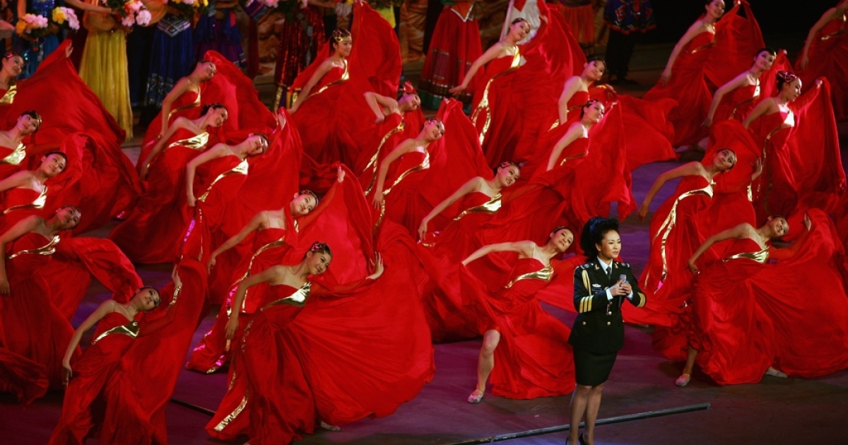 Peng Liyuan, a famous vocalist and expected to be China's next first lady, sings at the Great Hall of the People on July 30, 2007, in Beijing, China.</p>