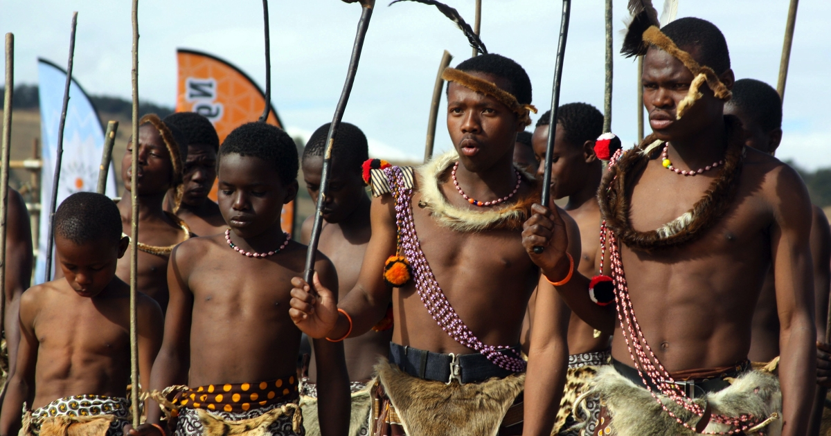 Men and boys of Swaziland's King Mswati III's warrior regiment perform on July 15, 2011 in Mankayane during a speech delivered by the king (not pictured). Mswati has called for his male subjects to get circumcised as he endorsed a campaign aimed at tackling the world's highest HIV infection rate.</p>