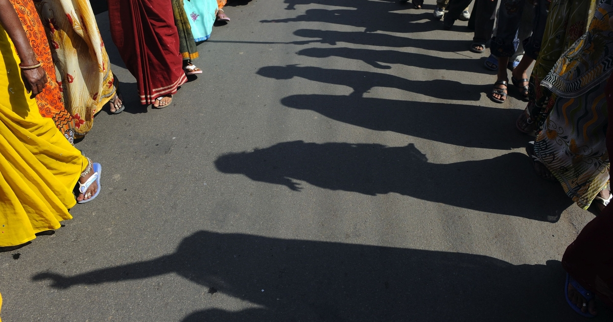 Men and women gather in Bhopal, India.</p>