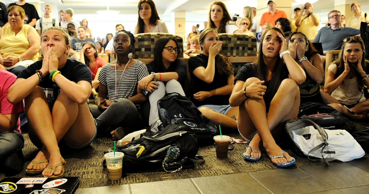 Penn State students and others react to the sanctions the NCAA announced against the university in the HUB on the campus July 23, 2012 in State College, Pa.</p>