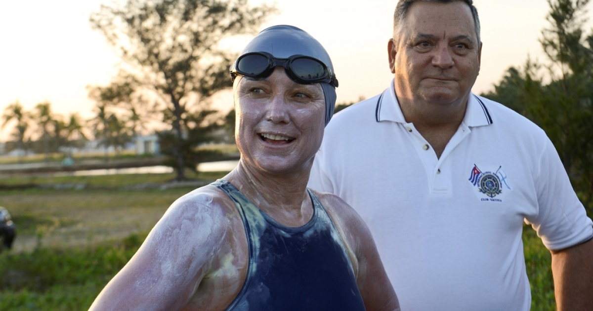 World Champion Marathon swimmer and world record in open water swimming, Penny Palfrey, photogrpahed before her attempt to swim from Cuba to the US.  She is standing next to the Cuban commodore of the Hemingway International Yacht Club in Havana, Jose Miguel Diaz.</p>