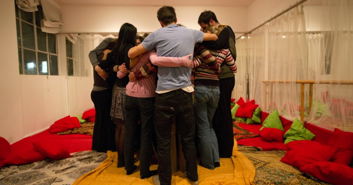 People embrace during a 'Cuddle Workshop' in London on Nov. 4, 2012.</p>