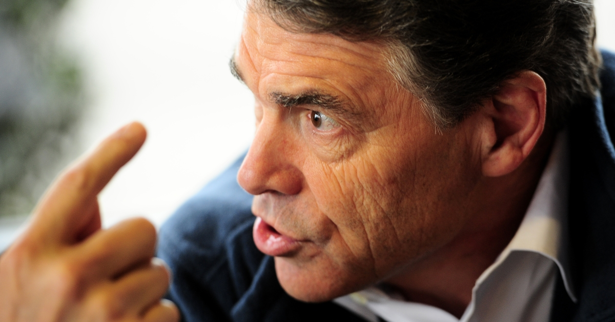 Republican presidential hopeful Rick Perry gestures as he has lunch with supporters today at the Drive-In Restaurant in Florence, South Carolina. He is tied for last place in a recent poll with former Utah Governor Jon Huntsman.</p>