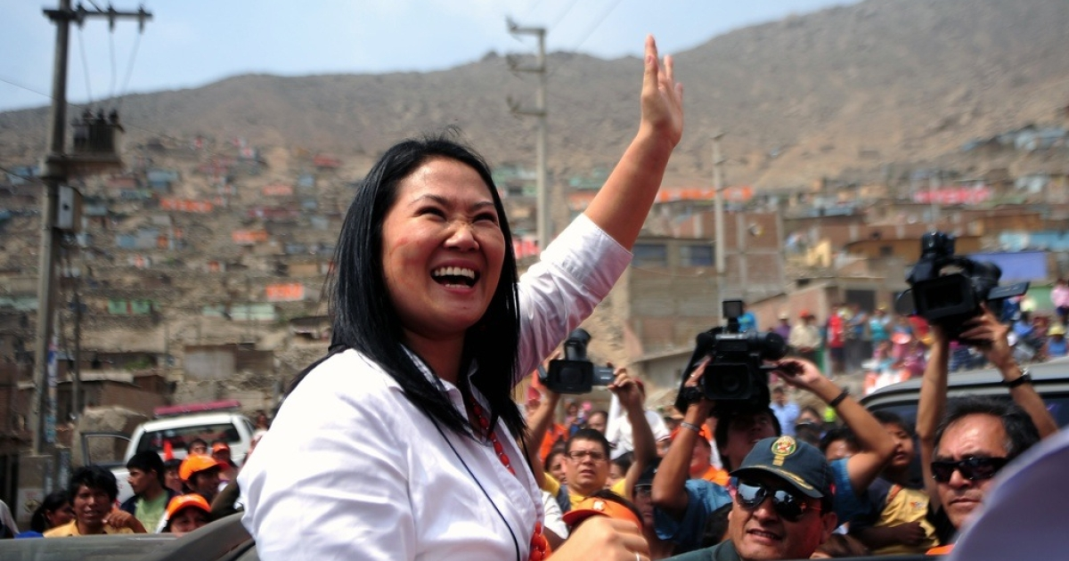Keiko Fujimori waves to the crowd after a conference to announce her candidacy for Peru's presidential elections in a Lima shantytown, Dec. 7, 2010.</p>