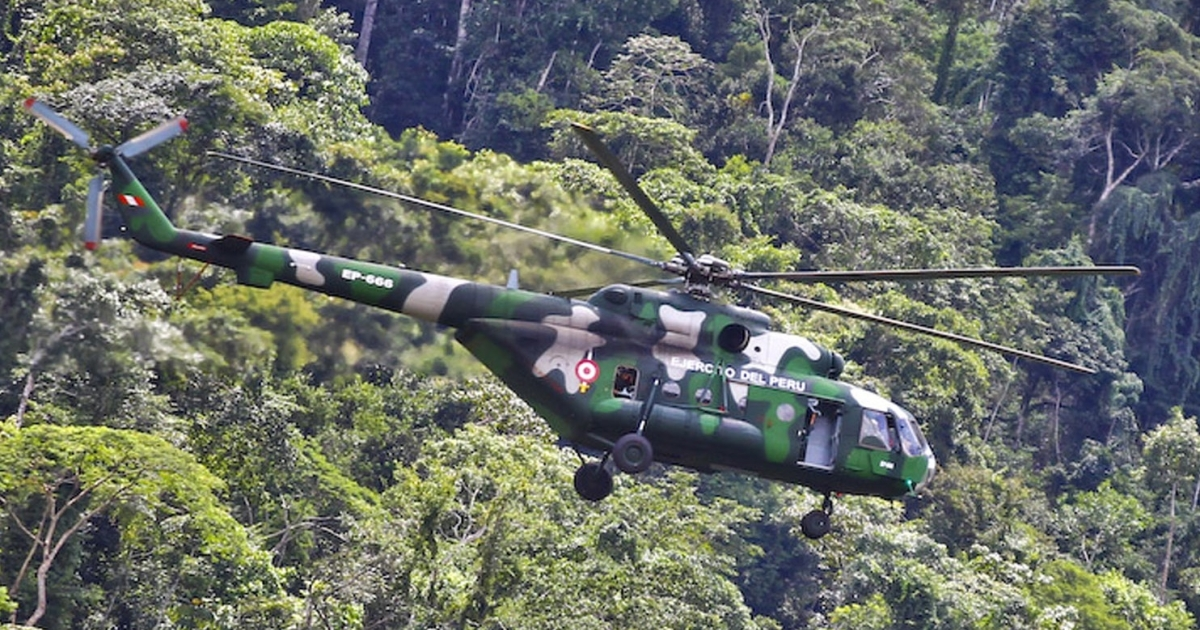 A Peruvian military helicopter patrols the remote jungle where Shining Path guerrillas kidnapped dozens of gas workers on April 9.</p>