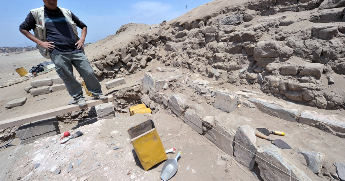 Archaeologist Jesus Holguin visits the excavation site at the Inca Sanctuary of Pachacamac on Nov. 9, 2010, where the remains of six canines and four children were found, in the coastal desert strip 30 km south of Lima.</p>