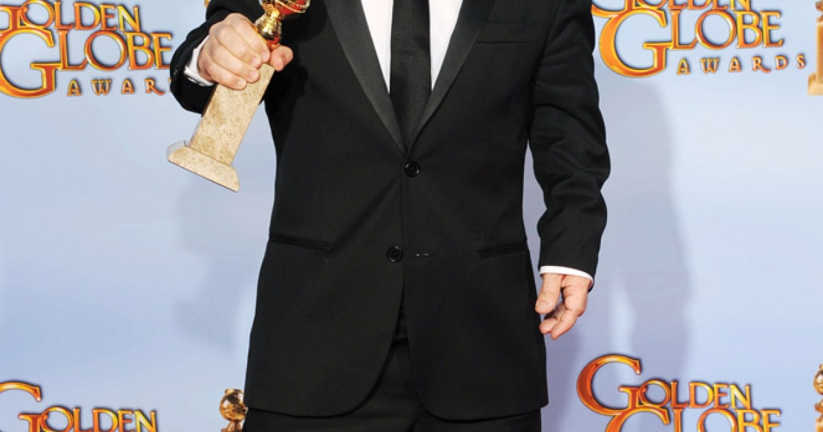 Actor Peter Dinklage poses in the press room with his award for