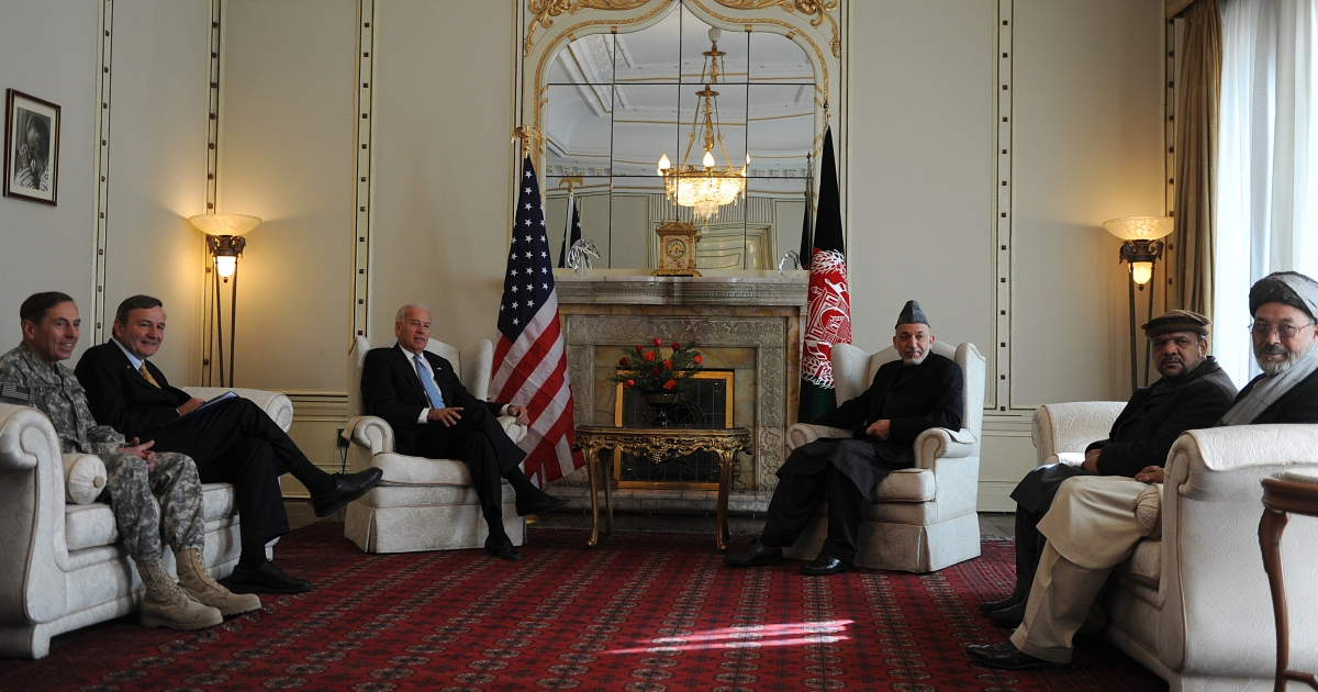 Afghanistan's President Hamid Karzai (3R), US Vice President Joe Biden (3L) and US General David Petraeus (L) look on during an official meeting at the Presidential palace in Kabul on Jan. 11, 2011.</p>