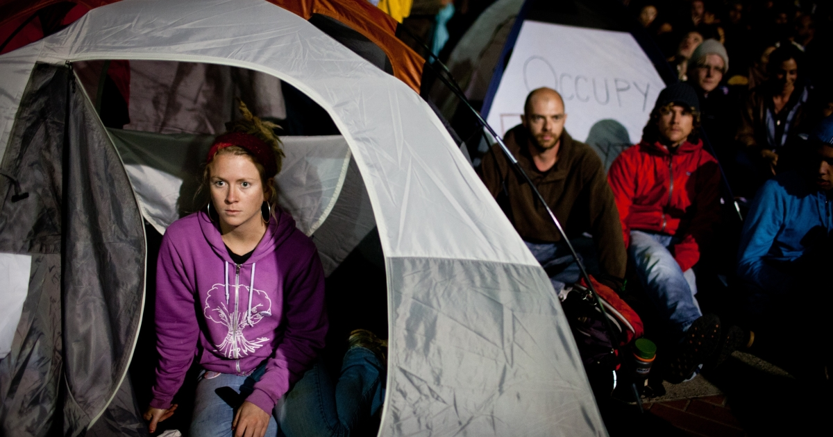 University of California-Berkeley student Colleen Young sits in her tent in Berkeley, Calif., after a general assembly voted to again occupy campus as part of an 'open university' strike in solidarity with the Occupy Wall Street movement on Nov. 15, 2011.</p>