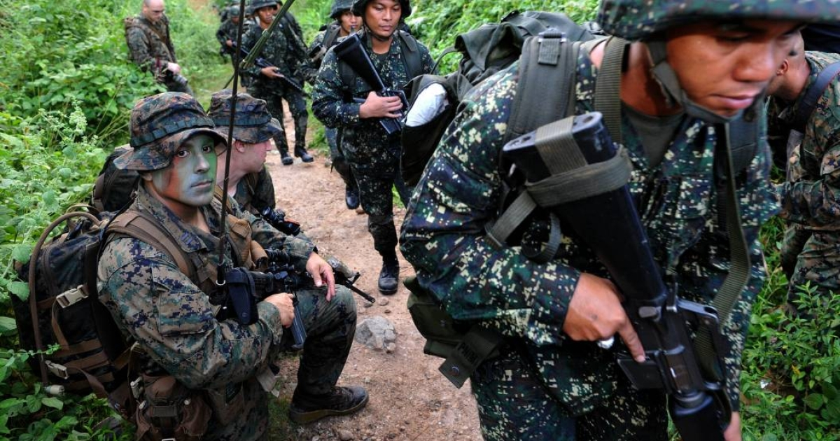 U.S. Marines provide training and intelligence to their Philippine counterparts in this file photo. Seven Philippine troops were killed in a battle with Islamic militants on Thursday.</p>