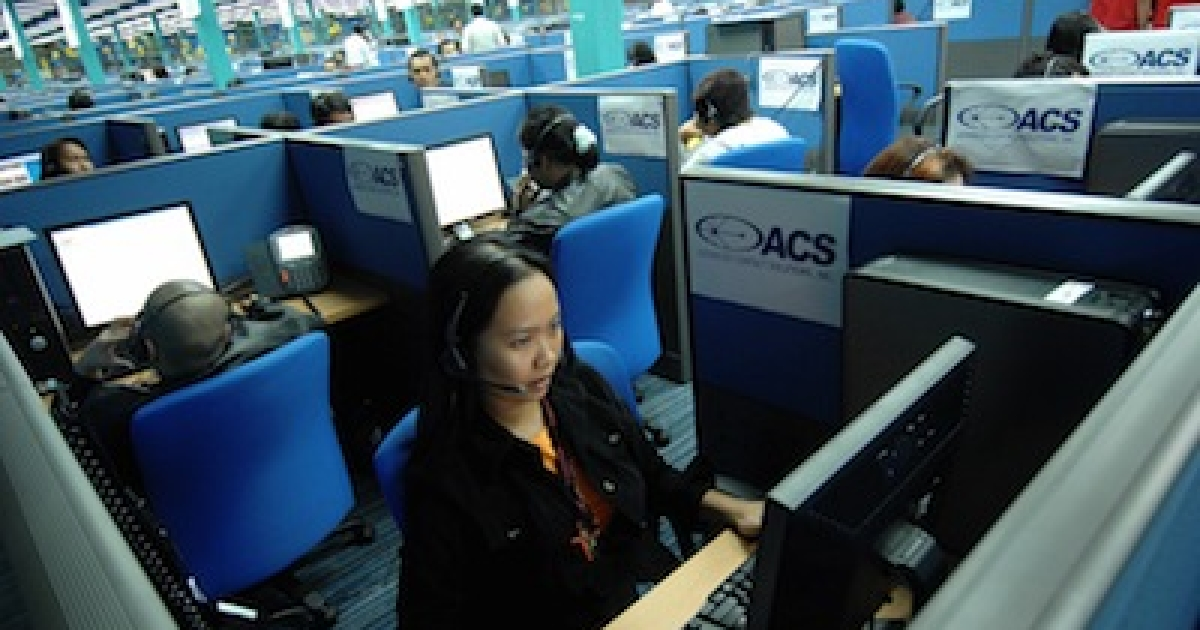 Filipino call center agents attend to U.S. clients at a call center in Quezon City outside the capital, Manila.</p>