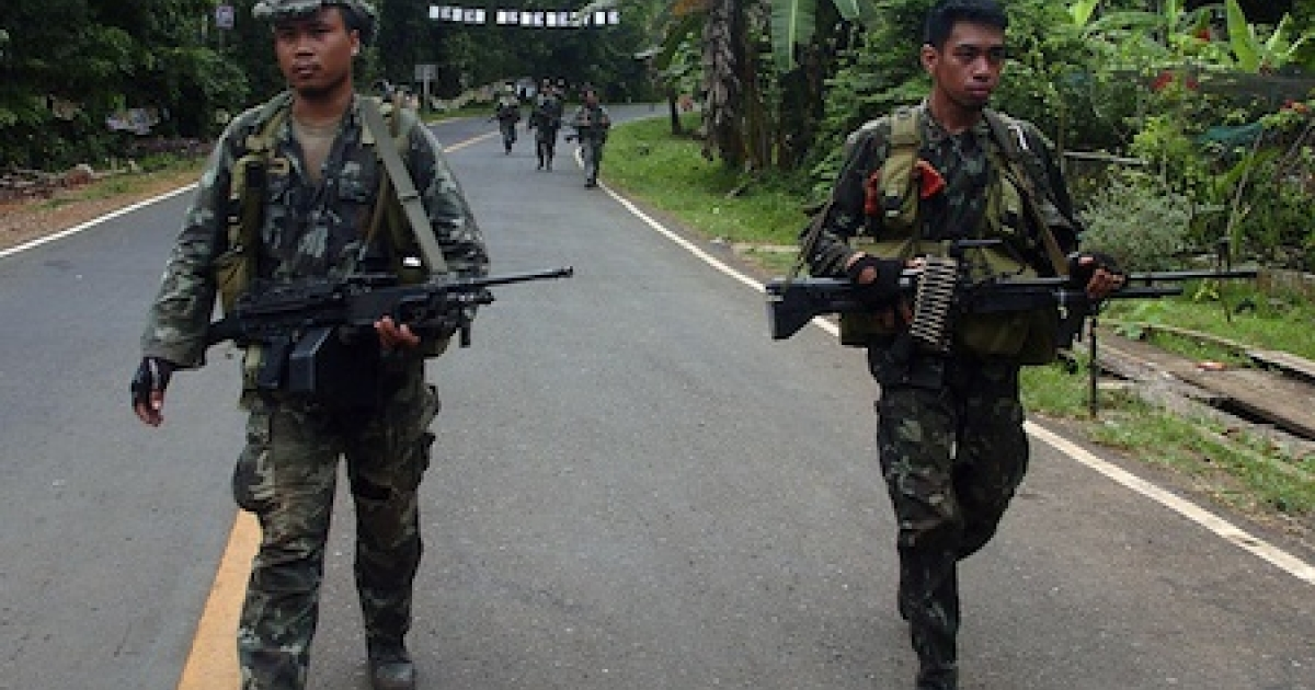 Philippine marines patrol a highway in the southern island of Mindanao on April 14, 2010 as they continue their hunt for militants.</p>