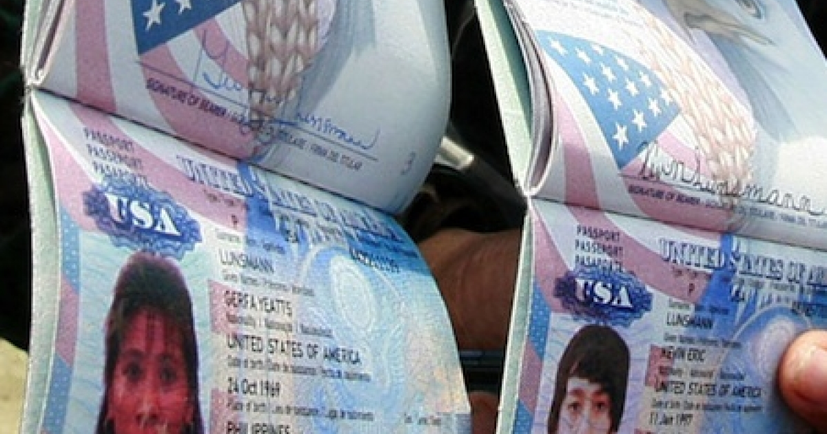 Police in the Philippines display two U.S. passports of Gerfa Yeatts Lunsmann and her son, Kevin, on July 12, 2011. Gunmen abducted two the U.S. citizens and their Filipino relative holidaying at a tiny southern Philippine island, police said. Gerfa Yeatts Lunsmann, 50, her son, Kevin, 14, and her Filipino nephew, Romnick Jakaria, 19, were snatched by more than a dozen gunmen who raided the island by boat before dawn.</p>
