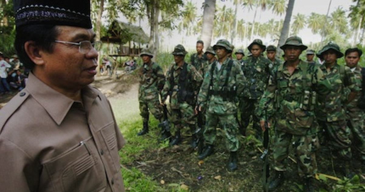 Murad Ebrahim, chairman of the Muslim separatists Moro Islamic Liberation Front (MILF) inspects his troops at the rebels' base in Camp Darapanan in Maguindanao province located in southern Philippine island of Mindanao. After more than 30 years of insurgency to set up an Islamic state in the largely Roman Catholic Philippines, Murad and his 12,000 fighters are ready for peace talks with the government.</p>