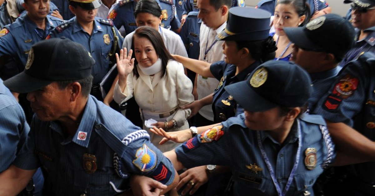 All smiles:  Former president Gloria Arroyo makes a ten-minute appearance at a Manila courtroom to plead not guilty to electoral fraud before being whisked back to the military hospital where she is being detained and treated for a spine condition</p>