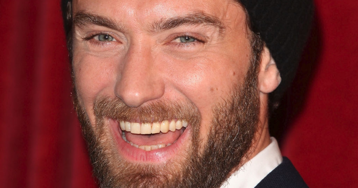 Phone-hacking victim Jude Law smiling at a London premiere last month.  He is probably smiling again today after receiving damages in excess of $200,000 for having his phone-hacked from Rupert Murdoch's News International</p>