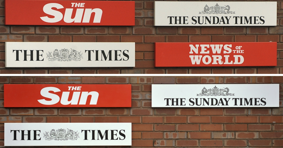 A combination of pictures illustrates the top picture taken on January 27, 2011, showing signage representing all four of News International's British newspapers and the picture below taken on July 17, 2011, showing the logo for the News of the World missing from outside of News International headquarters in east London.</p>