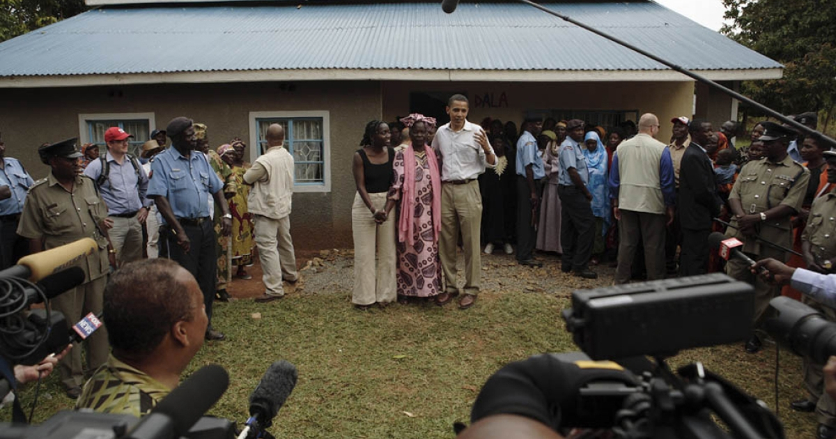 Then-Sen. Barack Obama with his step-grandmother and sister (left) at his ancestral home in the village of Siaya near Kisumu, northern Kenya, in August 2006.</p>