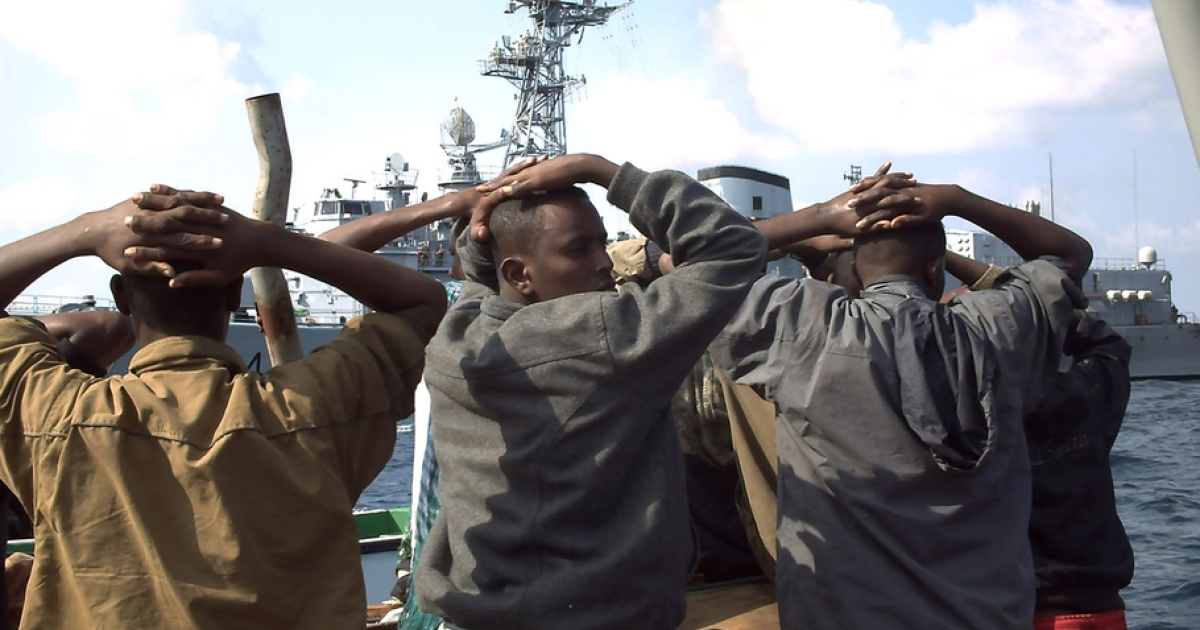 Several of the 19 captured Somali pirates, seen in this Jan. 4, 2009 photo released by the French Navy, with their hands on their heads, are taken to the French naval vessel