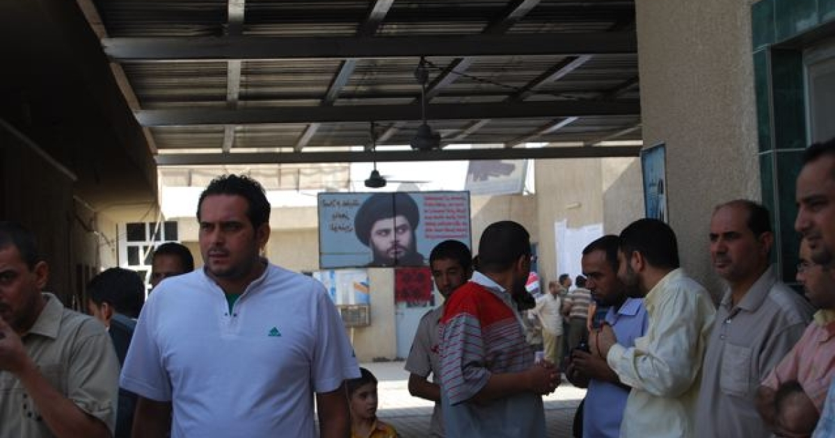Sadr supporters outside polling center in Sadr City.</p>