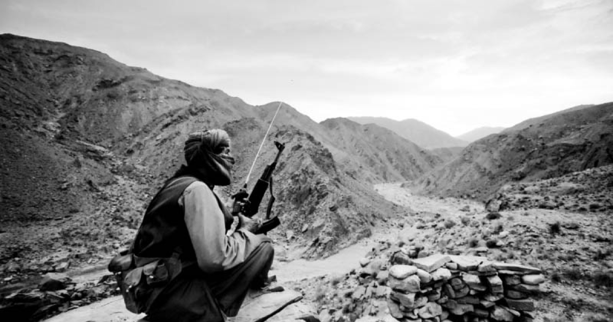 A Baluchistan Liberation Army (BLA) guerrilla fighter stands guard near a BLA camp in the scrubland of Bolan, a two-hour drive from Quetta, capital of the Pakistan province of Baluchistan.</p>