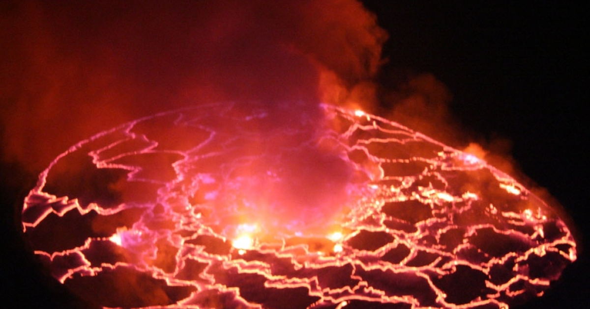 Fluid magma glows against the nighttime sky, 2,600 feet below the summit of Mount Nyiragongo.</p>