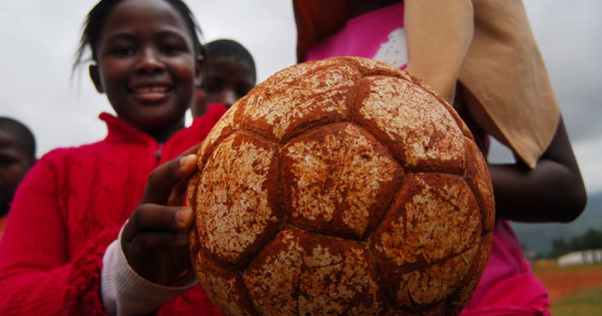Cynthia Sebosile, 13, plays football near Pholokwane, South Africa as part of a program to use soccer to promote AIDS education in the rural areas. Kids are taught about basic health, play football, and informative games, in a project created by SCORE.org.</p>