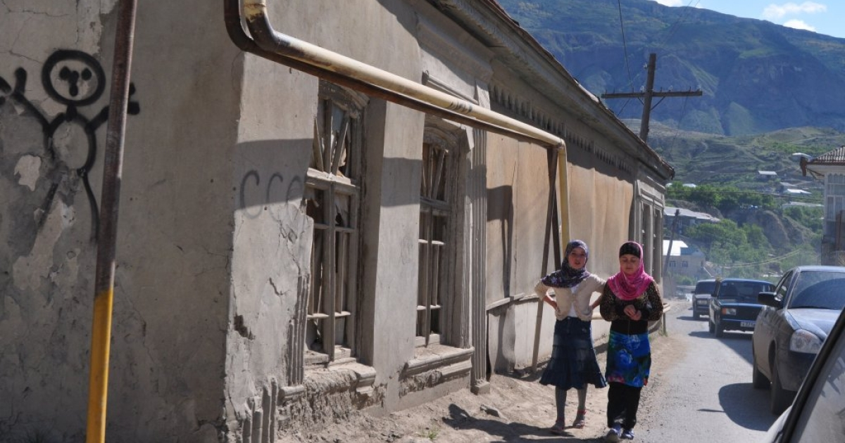 Two girls walk in a mountain village on the road from Makhachkala to Balakhani in Dagestan in May 2010.</p>