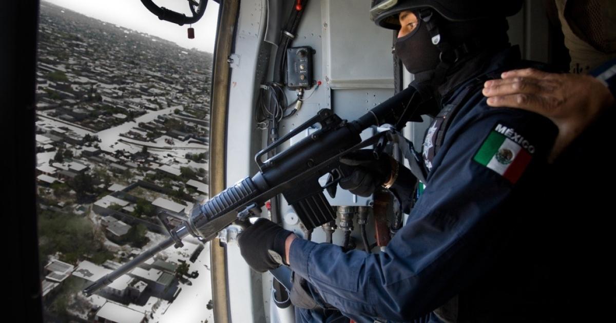 A police helicopter flies over Ciudad Juarez on patrol, April 8, 2010. (Jesus Alcazar/AFP/Getty Images)</p>