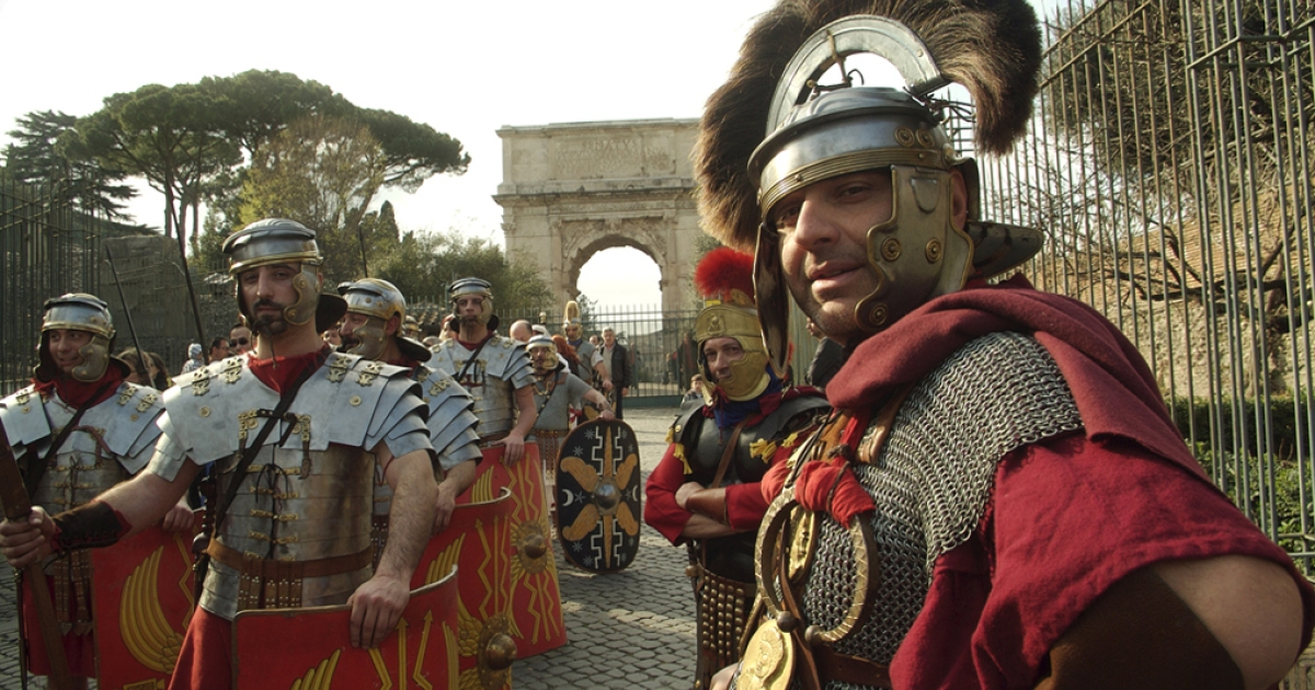 Giorgio Franchetti and his fellow SPQR group members rest after marching through the Roman Forum. Franchetti says current Romans should protect the legacy of their city by keeping the memory of ancient Rome alive. (Fulvio Paolocci/GlobalPost)</p>