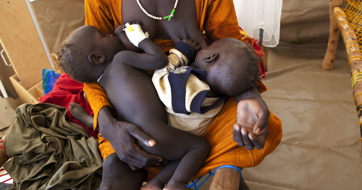 A Sudanese mother breastfeeds both of her small children who are hospitalized at the MSF ( Medecins Sans Frontieres ) field hospital at the Yida refugee camp along the border with North Sudan July 5, 2012 in Yida, South Sudan.</p>