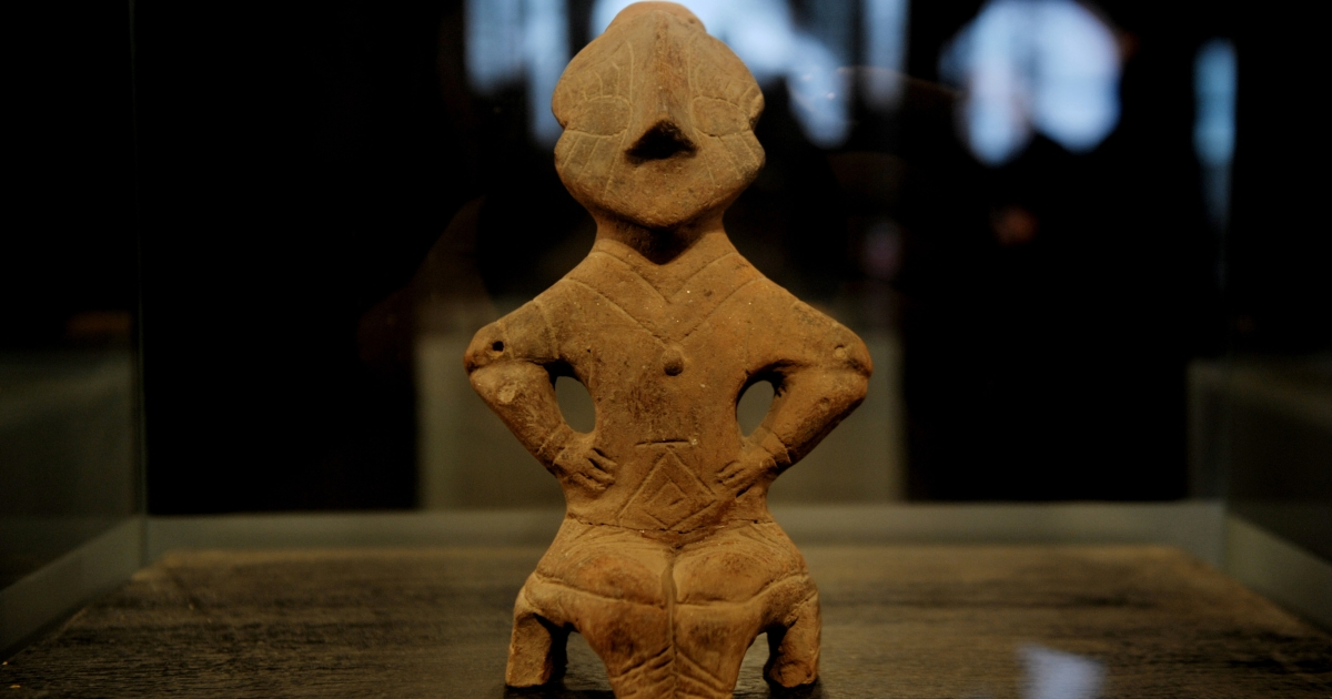 The Neolithic Goddess on the Throne a terracotta figurine is displayed on February 22, 2013 at the Museum of Kosovo in Pristina.</p>