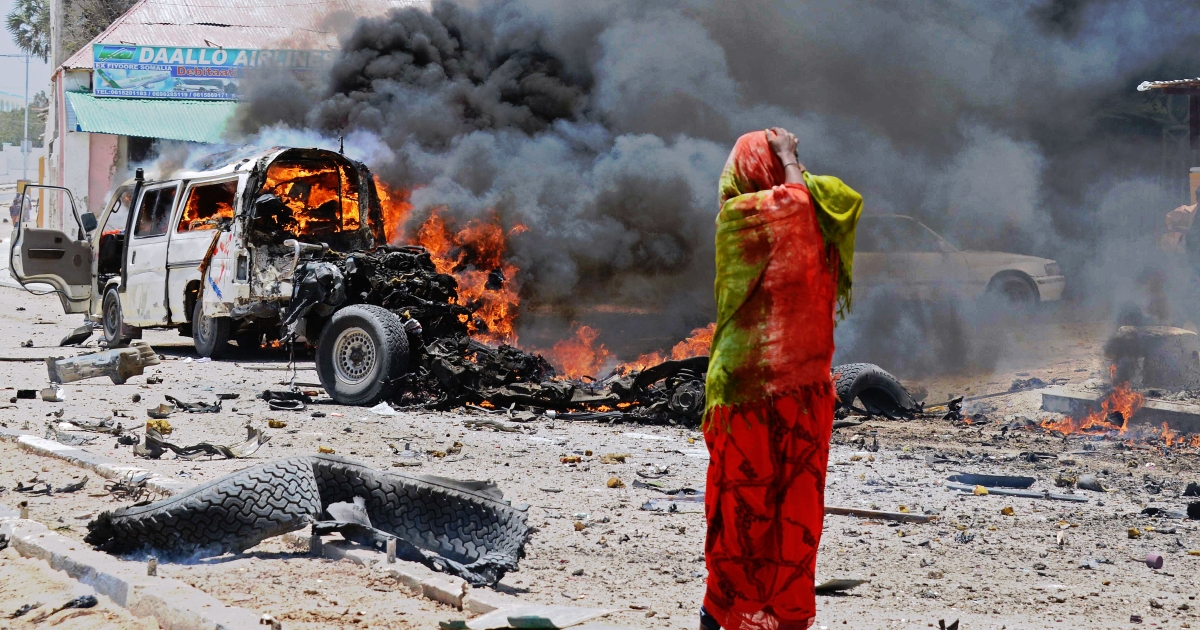 A Somali woman reacts on March 18, 2013 near the site of a car bomb in central Mogadishu. Despite bouts of unrest, Somalia has shown signs of stability recently and last week the Universal Postal Union signed a deal that would see international mail return after 22 years.</p>